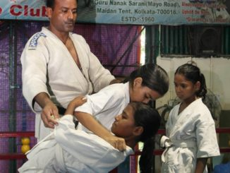 Students during practice at Calcutta Judo Club at back drop of a rare photo of (from left to right ) Santosh Chandra Majumder, Sanosan (sitting) and Tagore's son Rathindranath Tagore . Express photo by Partha Paul.20.06.16